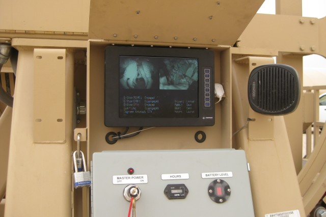Closed-circuit video monitor displays Soldiers from the 4th Brigade Combat Team, 1st Armored Division inverted in the Mine Resistant Ambush Protected--MRAP--egress trainer.  The Soldiers were conducting training at Camp Buehring prior to their movement to Iraq in May 2009.