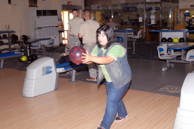 Miha Lee sets up as she begins to throw the ball for a punishing strike. Lee