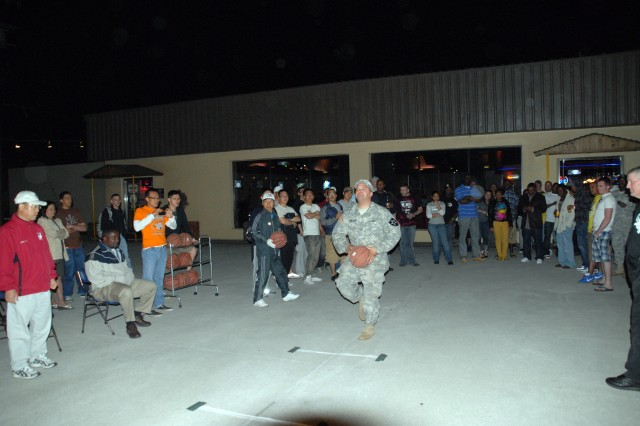 Soldiers shoot hoops for prize money