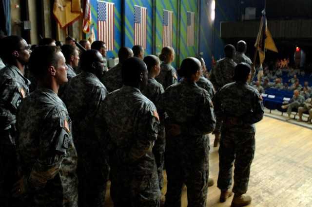 Soldiers of Headquarters and Headquarters Company, 548th Combat Sustainment Support Battalion and HHC, 751st CSSB listen as their respective unit histories are recited during a transfer of authority ceremony on Al Asad Air Base, Iraq May 3. The 548th CSSB will return to Fort Drum, N.Y., after a 15-month deployment supporting Coalition operations in western Iraq.