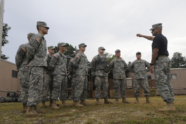 First Sgt. Juan Perez (right), the First Sergeant of the 82nd Airborne Pre-Ranger Course, gives instructions to the competitors in the 2009 82nd Airborne Division NCO & Trooper of the year competition prior to the warrior tasks and drills portion of the event held at the Pre-Ranger Course May 7.