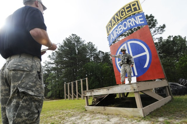 Staff Sgt. Jeremiah Waggoner (left), a pre-ranger instructor at the 82nd Airborne Pre-Ranger Course, grades Sgt. Bonifacio Lomeli, of HHC, Division Special Troops Battalion, 82nd Airborne Division, on the performance of hand and arm signals during the warrior tasks and drills portion of the 2009 82nd Airborne Division NCO & Trooper of the year competition May 7.