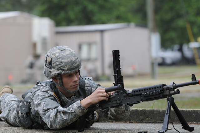Spc. Anthony Stollenmaier, of HHC, 2nd Brigade Combat Team, 82nd Airborne Division, corrects a malfunction on an M240B machine gun during the warrior tasks and drills portion of the 2009 82nd Airborne Division NCO & Trooper of the year competition May 7.