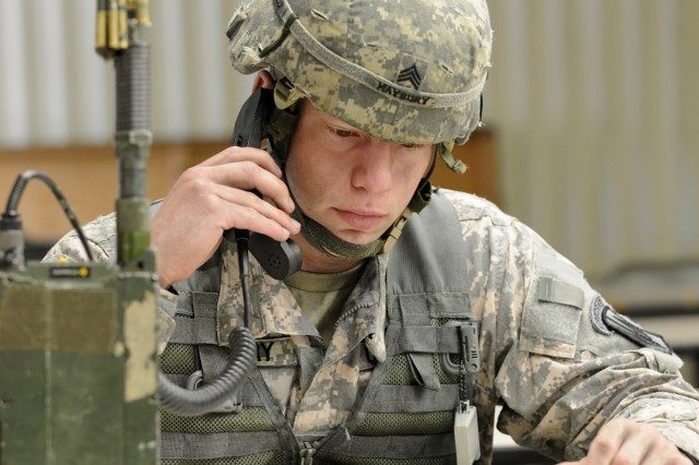 Sgt. Zach Maybury, of Co. B, 327th Field Artillery Regiment, 18th Fires Brigade, calls up a 9-Line medevac request during the warrior tasks and drills portion of the 2009 82nd Airborne Division NCO & Trooper of the year competition May 7.