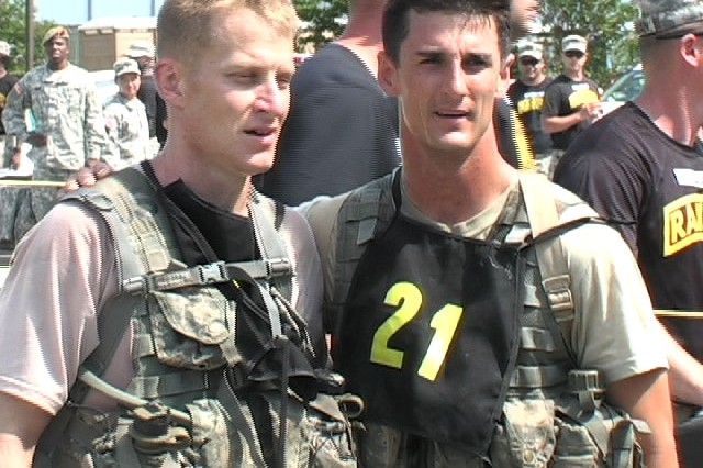 Sgt. 1st Class Blake Simms and Sgt. 1st Class Chad Stackpole, Team 21, 4th Ranger Training Battalion, pose after crossing the finish line on Day 3 of the 2009 Best Ranger Competition.