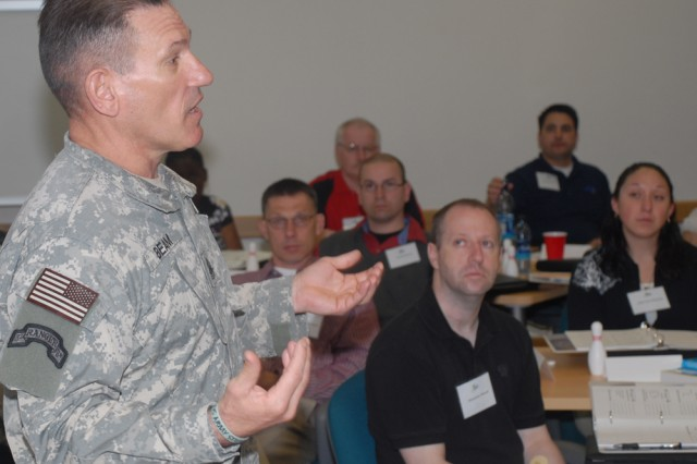 U.S. Army in Europe Command Sgt. Maj. Ralph Beam addresses participants during Better Opportunities for Single Soldiers training, where he encouraged everyone involved to work more closely with leadership at mission units.