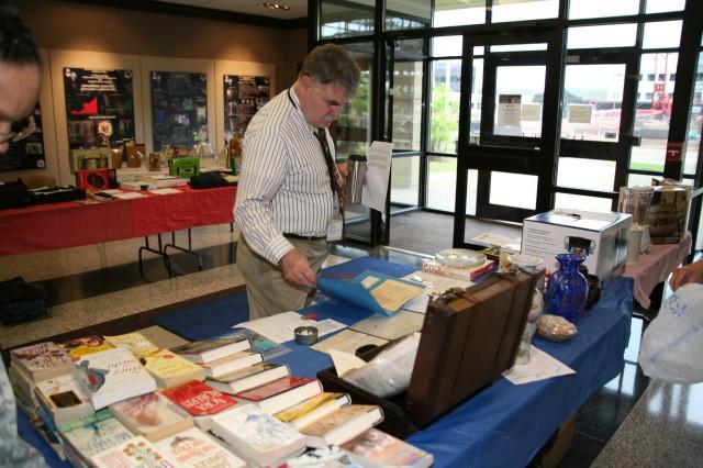 John Davis browses the historical memorabilia.