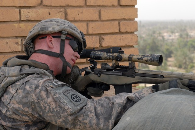 BAGHDAD - Pfc. John Motte, from Salem, Ore., a sniper with 1st Battalion, 505th Parachute Infantry Regiment, keeps a vigilant watch with his M-14 rifle. Motte and other paratroopers provide a security detail for Brig Gen. John Murray, deputy commander for maneuver for Multi-National Division-Baghdad and the 1st Cavalry Division, during his visit to Salman Pak, May 7.