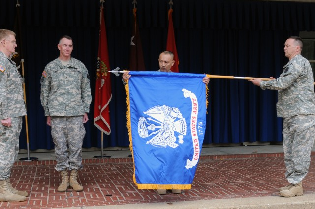 Sgt. 1st Class Jacque Keeslar presents the new Warrior Transition Command colors to WTC senior enlisted advisor Sgt. Maj. Ly M. Lac as Lt. Gen. Eric B. Schoomaker, Medical Command chief (far left) and new WTC commander Brig. Gen. Gary H. Cheek await the transfer.