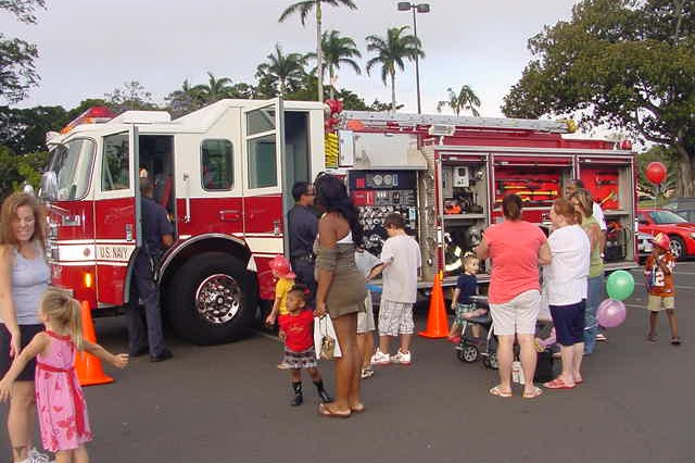 SCHOFIELD BARRACKS, Hawaii - The Federal Fire Department (FFD) showcases engine 115 from the Schofield Barracks Fire Station during the Baskin-Robbins/FFD ice cream social event, April 29.