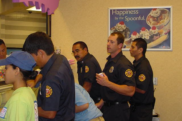SCHOFIELD BARRACKS, Hawaii - Firefighters from the Federal Fire Department's Station 15 help scoop ice cream in support of Baskin-Robbins 31 cent a Scoop Night at Post Exchange Mall Food Court, April 29.