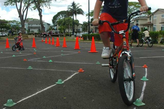 SCHOFIELD BARRACKS, Hawaii - Brody Christensen, 11, nears the finish line of the obstacle course during the bike rodeo at Porter Community Center, May 2. The rodeo brought family members of all ages to learn about bike safety and strengthen abilities as a rider.