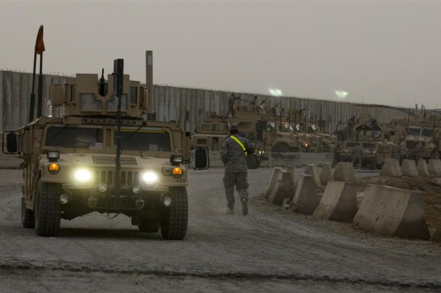 Military vehicles queue up for convoy mission inside the yard at Convoy Support Center Scania, Iraq April 16. Convoys routinely stop at CSC Scania to rest and refuel on their way to a final destination.