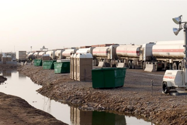 A line of fuel trucks wait for a convoy mission to begin inside the yard at Convoy Support Center Scania, Iraq April 18. Convoys routinely stop at CSC Scania to rest and refuel on their way to a final destination.