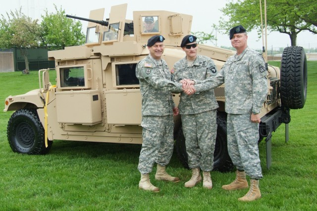 Rock Island Arsenal Joint Manufacturing and Technology Center Commander, Col. Craig S. Cotter (from left), Master Sgt. Jeffrey Mittman, and Program Manager for Tactical Vehicles, Col. Scott Kidd, poses in front of the first FRAG Kit 6 at a roll out ceremony at Rock Island Arsenal.