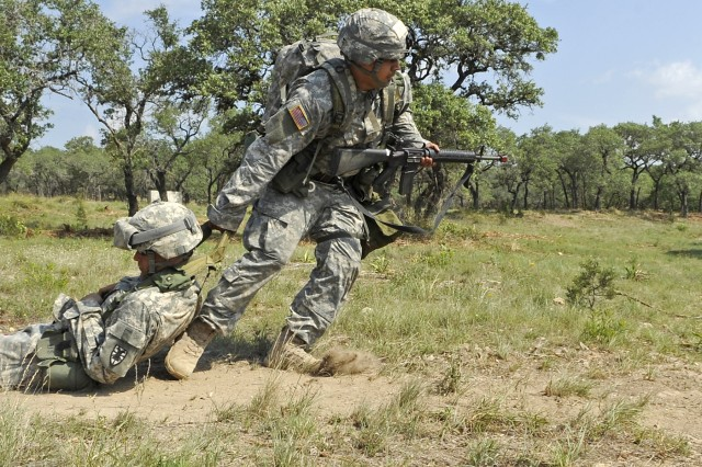 2nd Lt. Jose Juarez simulates dragging a wounded Soldier to safety during a phase of the Expert Field Medical Badge testing at Camp Bullis, Texas.  Juarez is assigned to the 61st Multifunctional Medical Battalion at Fort Hood, Texas.