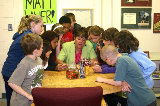 Shawne Cryderman, West Point Elementary School principal, confers with the fourth grade energy group and good citizens club. Cryderman will retire in August and plans to create a children\'s theater in Arizona, ride her bike and play pickleball-a kind of mini-tennis game.