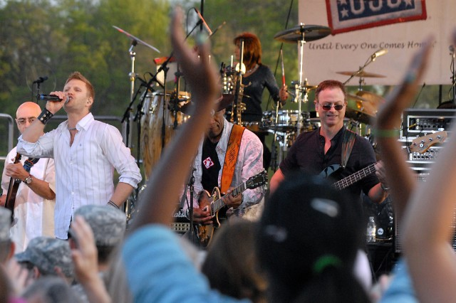 "Lt. Dan Band vocalist Jeff Vezain; guitarist, vocalist and veteran Kimo Williams; and bassist Gary Sinise, known for his roles in ""Forrest Gump"" and on ""CSI:NY,"" entertain Fort Leavenworth troops, spouses and other community members May 8 at Merritt Lake."