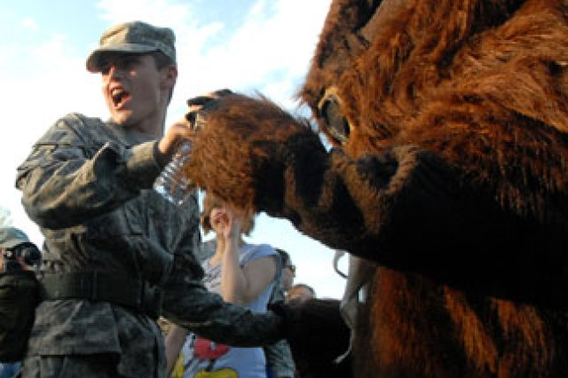 Junior ROTC cadet Tim Craig, of Smith-Cotton High School in Sedalia, Mo., dances with Leavy, the Family and Morale, Welfare and Recreation bison mascot, during the Lt. Dan Band concert May 8 at Merritt Lake. Craig and other cadets from nine high schools competed the next day in the Raider Challenge sponsored by Leavenworth High School JROTC.