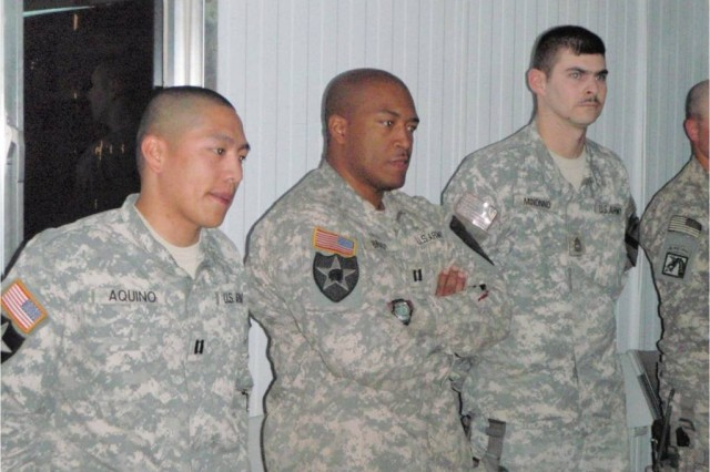 "BAGHDAD-From left to right:  Capt. Alex Aquino, Capt. Andre Brady, and Master Sgt. Gregory Minonno.  The Squadron held a punch bowl ceremony at JSS Istiqlal on April 27 to honor these three leaders who have since left the 1st ""Garryowen"" Squadron, 7th Cavalry Regiment, 1st Brigade Combat Team, 1st Cavalry Division.    Capt. Aquino will take command of a Field Artillery Battery at 1st Battalion, 82nd Field Artillery Regiment in Ironhorse Brigade.  Capt. Brady will go to the Brigade Intelligence Shop and Master Sgt. Minonno is returning to the States to attend the Sergeants' Major Academy.  These three leaders have contributed greatly to the Squadron and will be missed."