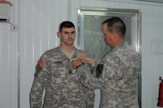 "BAGHDAD-Command. Sgt. Maj. Mervyn Ripley (right) affixes the Meritorious Service Medal to Master Sgt. Greg Minonno's collar May 7, during a ceremony on Joint Security Station Isitqlal .  Master Sgt. Minonno received the award for his exceptional service to the 1st ""Garryowen"" Squadron, 7th Cavalry Regiment, the 1st Brigade Combat Team, and the 1st Cavalry Division over the past several years.  Master Sgt. Minonno will soon leave the Squadron to attend the Sergeants' Major Academy."