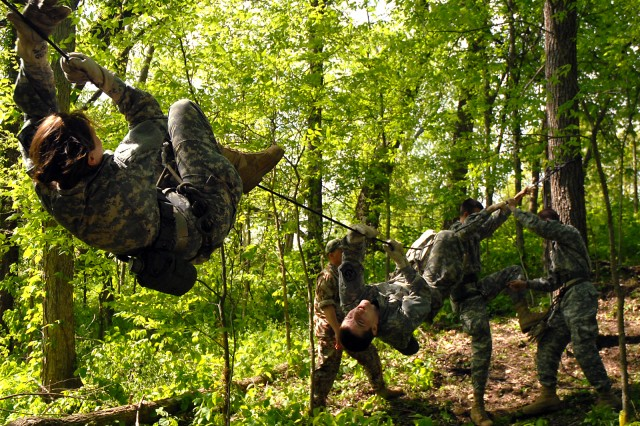 Cadet 2nd Lt. Lauren Sparks and Cadet Sgt. 1st Class Seth Pennock, of  St. Joseph, Mo., Pony Express Raider Challenge A Team, cross a one-rope bridge as Cadet Sgt. Jonathan Montgomery and Cadet Capt. Micah Carr prepare to do the same during the timed event in the Leavenworth High School-sponsored Raider Challenge May 9 near Camp Conestoga, Fort Leavenworth, Kan. Sparks received a second place trophy for the second-highest female physical fitness score of 299.