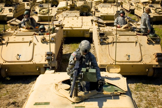 Revving up for the armored pass and review, Soldiers from 2HBCT, 3rd ID, prepare their vehicles for a Pass in Review at Fort StewartAca,!a,,cs Taylor Creek training grounds, May 8.