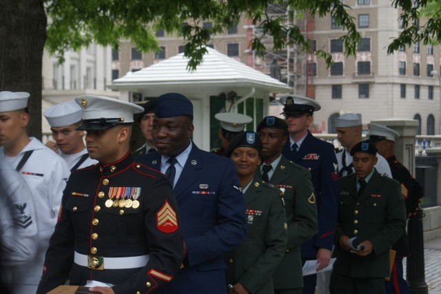 Spc. Chyshann Pierre (center), of the 1st Special Troops Battalion, 1st Brigade Combat Team, 101st Airborne Division, marches in a Naturalization ceremony at the White House on May 1, 2009.  Pierre earned her U.S. citizenship after deploying to Iraq with the famed Bastogne Brigade of the 101st Airborne Division.