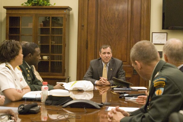 """Students discuss the defense budget and appropriations process with Oregon Senator Jeff Merkley. """"Talking with our congressman really gave us first hand insight to current policy and appropriations that impact our national security both domestically and internationally,"""" said Col Timothy Starke."""