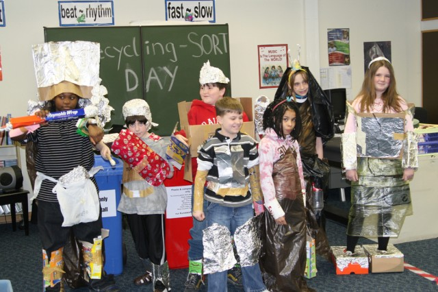 Rainbow Elementary students at U.S. Army Garrison Ansbach, Germany, show off their recycling fashion statements during a fashion competition as part of the Separate or Recycle Trash School Days.