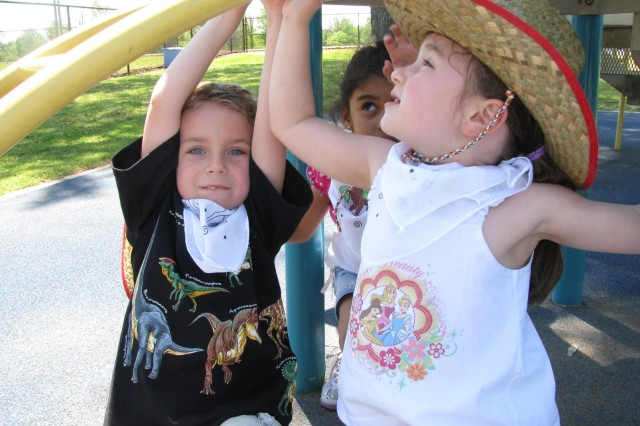 Raiko Golden, Catalina D'Ambrosio-Rivera and Kalea Connolly hang out together on the monkey bars during Western Day. The cowboy and cowgirls had a great time pretending to be in the Wild West.