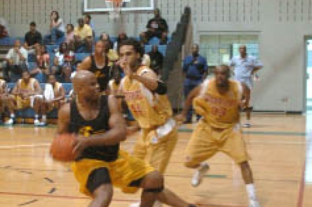 Members of the men's All-Army basketball team played two games at Fort Gillem's Neal Fitness Center for members of the local military community.  The team beat the Carterville Summerhill semi-professional team by a score of 69 to 68 May 2, then defeated the Atlanta Speedboys team by a score of 70 to 64 May 5. The All-Army team stopped to play the games en route to the Armed Forces Basketball Championship that runs from 10 thru 18 May.