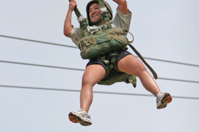 Francine Sablan, an Army wife, jumped from the 34-foot tower during the Military Spouses Day Conference event, May 8, at Fort Bragg, N.C.