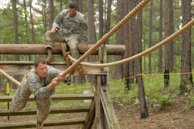 Maj. Craig Gendreau (left), the executive officer for the 96th Civil Affairs Battalion (Airborne), and Command Sgt. Maj. Thomas Wall, the 95th CA Brigade command sergeant major, cross a rope on Darby Queen obstacle course during the 2009 Best Ranger Competition at Fort Benning, Ga., May 8. Both made up one of three teams sent from the 95th Civil Affairs Brigade for the first time since the unit's formation.""