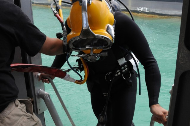 Capt. John Darrow, commander, 7th Engineer Dive Detachment, prepares to go into the water during a test dive, May 11, at Hickam Air Force Base, Hawaii.