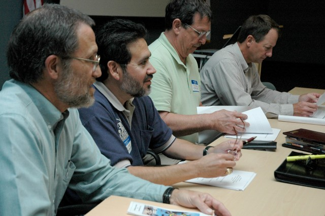 (March 23, 2009) - Members of the Corpus Christi Army Depot business development team prepare their notes just prior to presenting machine shop contracting opportunities at a seminar hosted by Del Mar College, the Corpus Christi Regional Economic Development Corp. and the Corpus Christi Army Depot. (l-r) Gary Richmer, David L. Garcia, Ron Howe, Rod Wolthoff. Photo by Brigitte Rodriguez, CCAD Public Affairs. (RELEASED)