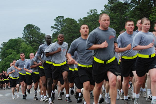 Rubber meets the road as thousands of Paratroopers from the 82nd Airborne Division take part in a four-mile division-wide run to kick off the 82nd's All American Week celebration May 18. The annual event celebrating the 82nd's history and accomplishments is taking place from May 18-21 this year, despite the Division's multiple ongoing deployments overseas. (U.S. Army photo by Staff Sgt. Mike Pryor, 2nd BCT, 82nd Abn. Div. Public Affairs)