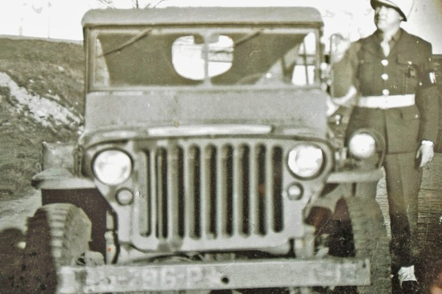Pvt. Charles W. Eubanks stands beside his jeep while serving in Germany during World War II.