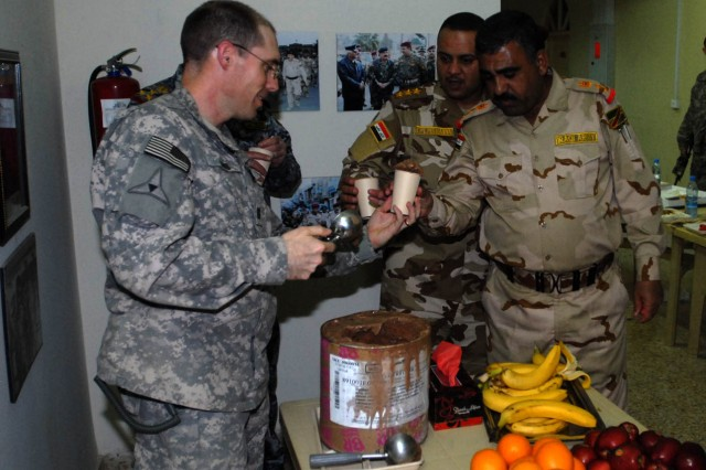 BAGHDAD- Mountain View, Ok. Native, Capt. Joe Kobs, prosecution task force officer for 1st Brigade Combat Team, 1st Cavalry Division, serves ice cream to leaders from the 11th Iraqi Army Division and Coalition forces after a joint weekly commanders meeting at the Old Ministry of Defense building May 16.  Coalition forces and the IA discuss and assess current security conditions in the northeast area of Baghdad and plan for improvements in the future.