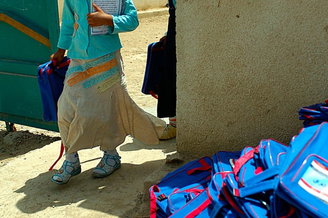 BAGHDAD-A student at the Hamichun School exits the school's courtyard carrying her brand new book bag full of school supplies donated by a group of Hemp Stead High School students, and their surrounding community members from Dubuque, Iowa May, 15.