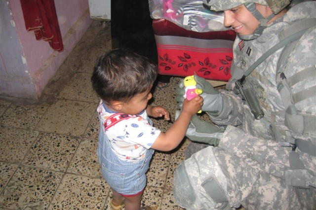 Seventh-graders, Soldiers reach out to Iraqi orphans