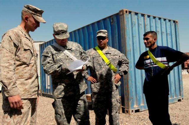 Iraqis and Marines trade welding skills