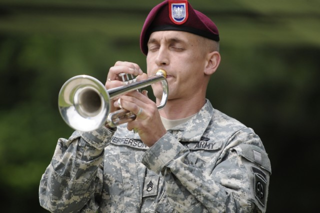 Staff Sgt. Luke Jefferson of the 82nd Airborne Division Special Troops Battalion plays taps at the All American Memorial Ceremony on May 18. The ceremony honored fallen Paratroopers of the division. (U.S. Army photo by Pfc. Kissta M. Feldner, 2nd BCT, 82nd Abn. Div. PAO)