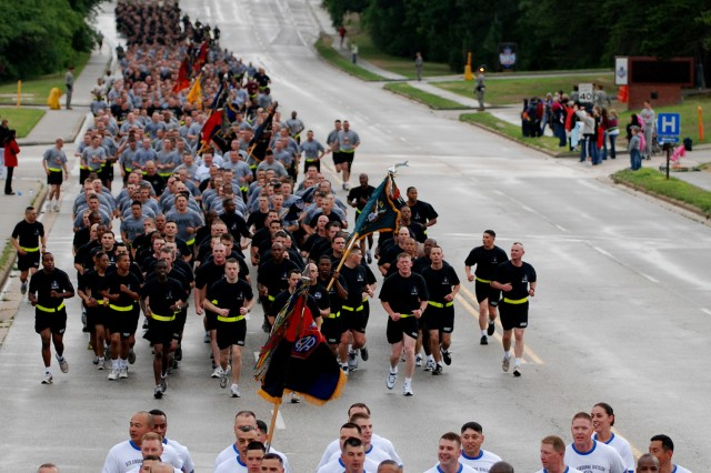 The command group of the 82nd Airborne Division, including the Division Commander, Maj. Gen. Curtis M. Scaparrotti (third from left), and Division Command Sergeant Major, Command Sgt. Maj. Thomas Capel (fourth from left), leads thousands of Paratroopers on a four-mile division run to kick off the 82nd's All American Week celebration May 18. (U.S. Army photo by Sgt. Stephen Decatur, 4th BCT, 82nd Abn. Div. Public Affairs)