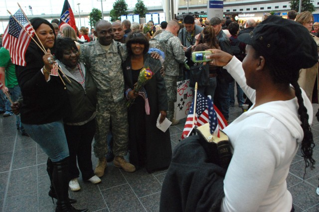 In this file photo, Sophie Render photographs her brother Spc. Jessie Miller (center) with Deborah Hester, a family friend; Rose Williams, his aunt; Jerry Render, his brother and Barnell Wilhite, his mother at the Indianapolis International Airport on Nov. 12, 2008.