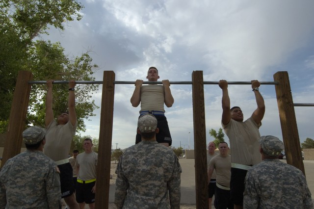Pre-Ranger students conduct chin-ups as part of the Ranger Physical Fitness Test during the Pre-Ranger Course, May 18.  (Photo by Sgt. Giancarlo Casem, 11th ACR Public Affairs)