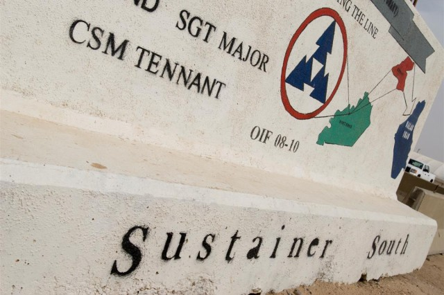 """The painted t-wall outside the """"Sustainer South"""" 3d Sustainment Command Expeditionary liaison officer cell at Camp Buehring, Kuwait."""