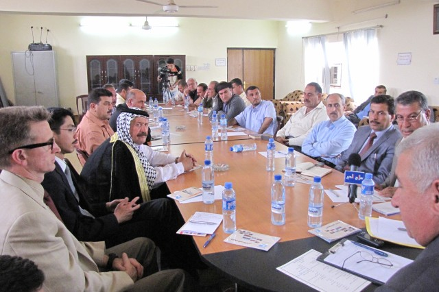 Members of the Salah ad-Din Provincial Investment Commission meet with potential entrepreneurs in Tuz April 30.  The Provincial Reconstruction Team organized the meeting to help boost the economic growth in the city and further improve the quality of life for citizens.