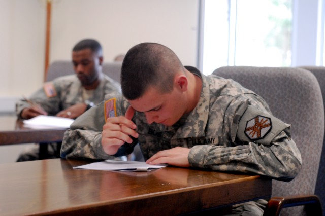 Competitors use brain versus brawn while tackling a knowledge test during the Installation Management Command-Europe Soldier of the Year and NCO of the Year competition May 10-13 at USAG Grafenwoehr.