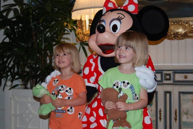 Keara (left) and Lauren Witt, twin daughters of Staff Sgt. Jeremiah Witt, chaplain assistant for the 3rd Heavy Brigade Combat Team, 3rd Infantry Division, get their picture taken with Minnie Mouse during the 1st Battalion, 15th Infantry Regiment, 3rd HBCT's marriage retreat to Orlando, Fla. May 8 - 10.